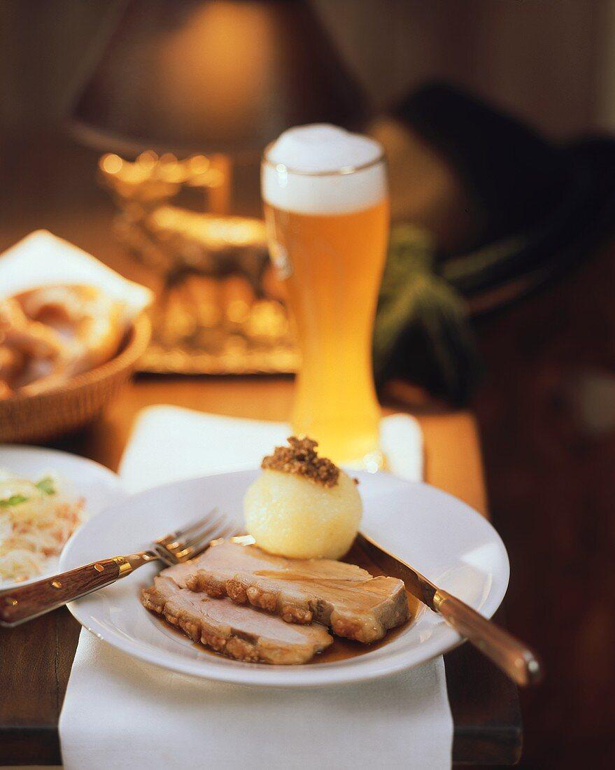 Roast pork with crackling, with potato dumpling; Weissbier