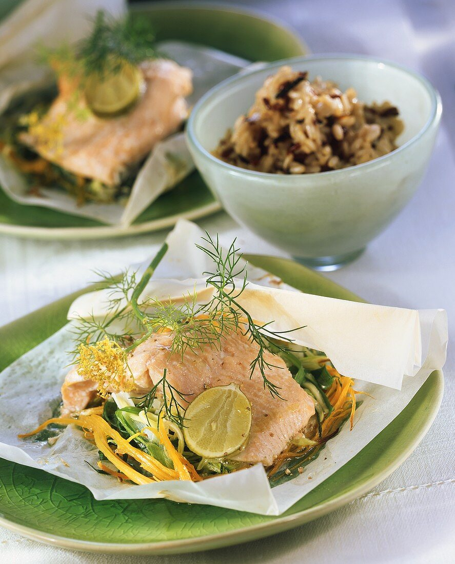 Salmon trout with vegetables on greaseproof paper; wild rice