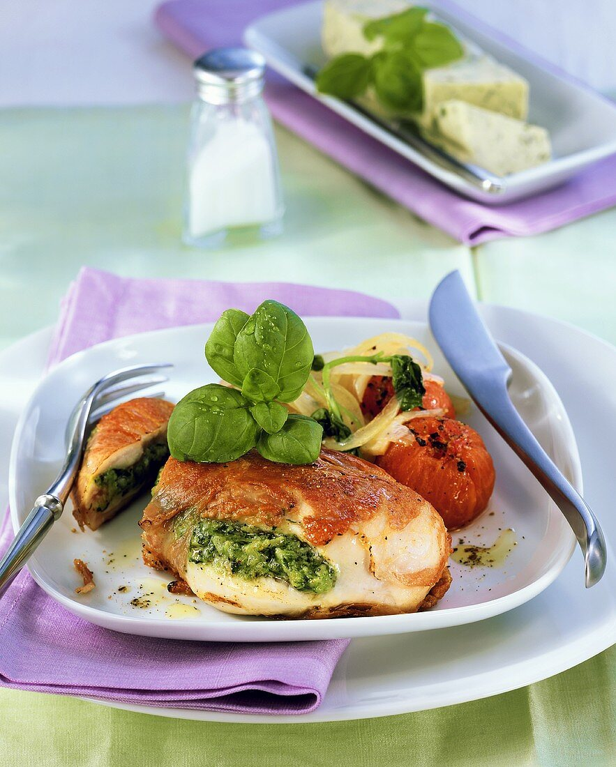 Chicken breast stuffed with herb butter, cheese and ham