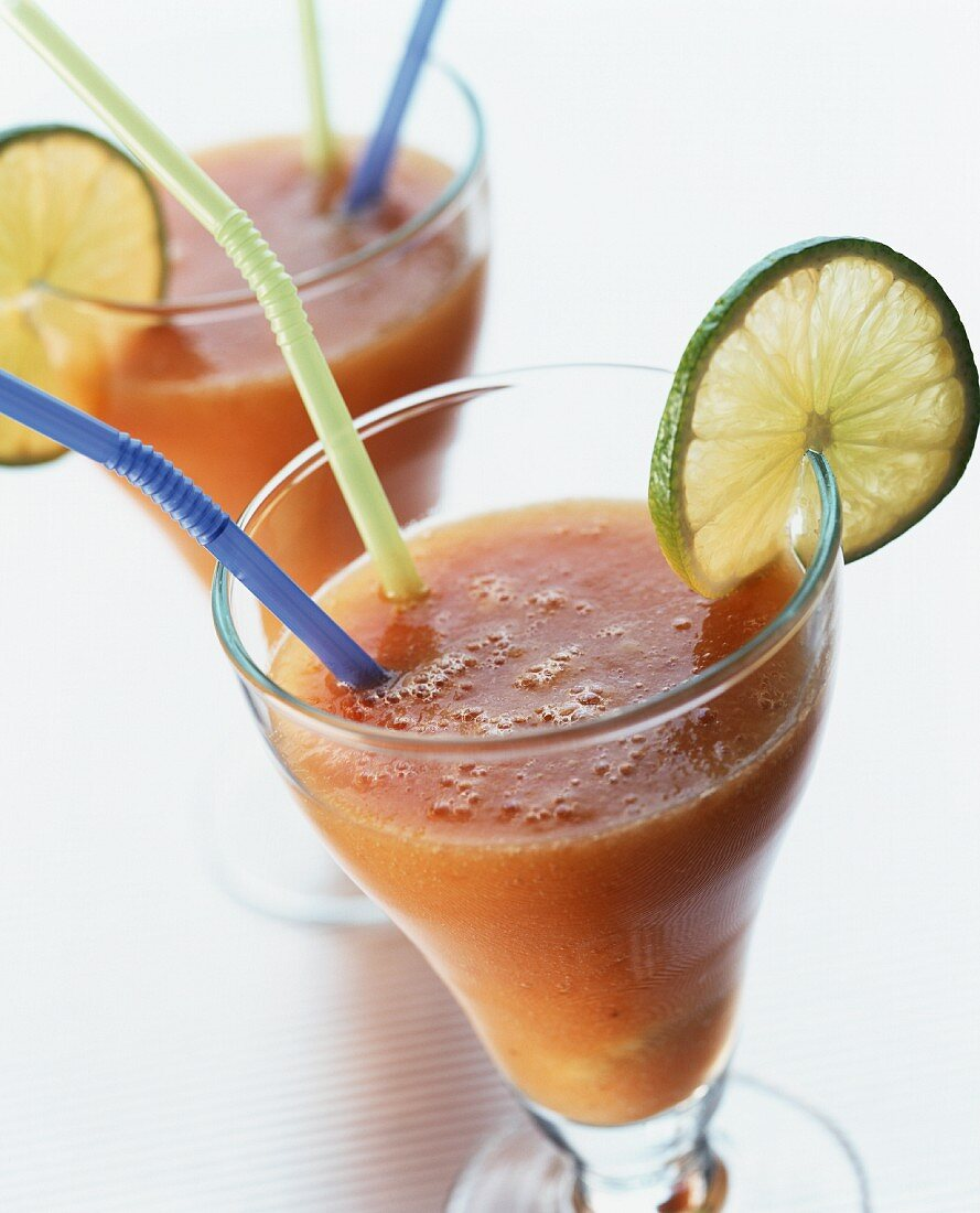 Two glasses of peach and lime drink