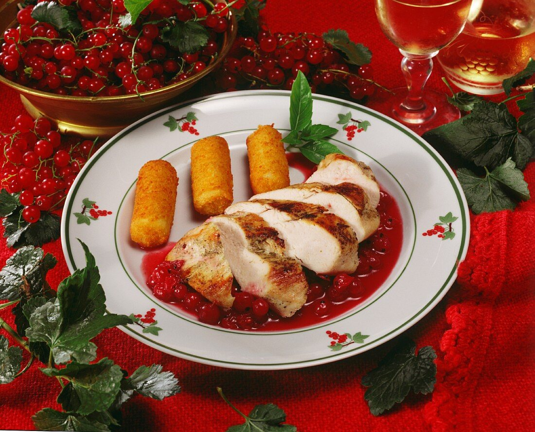 Chicken breast with redcurrant sauce and croquettes