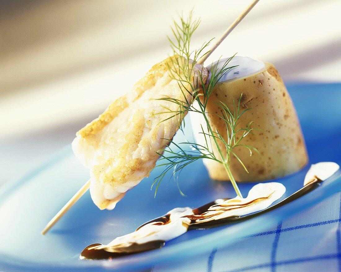 Monkfish fillet on skewer with baked potato