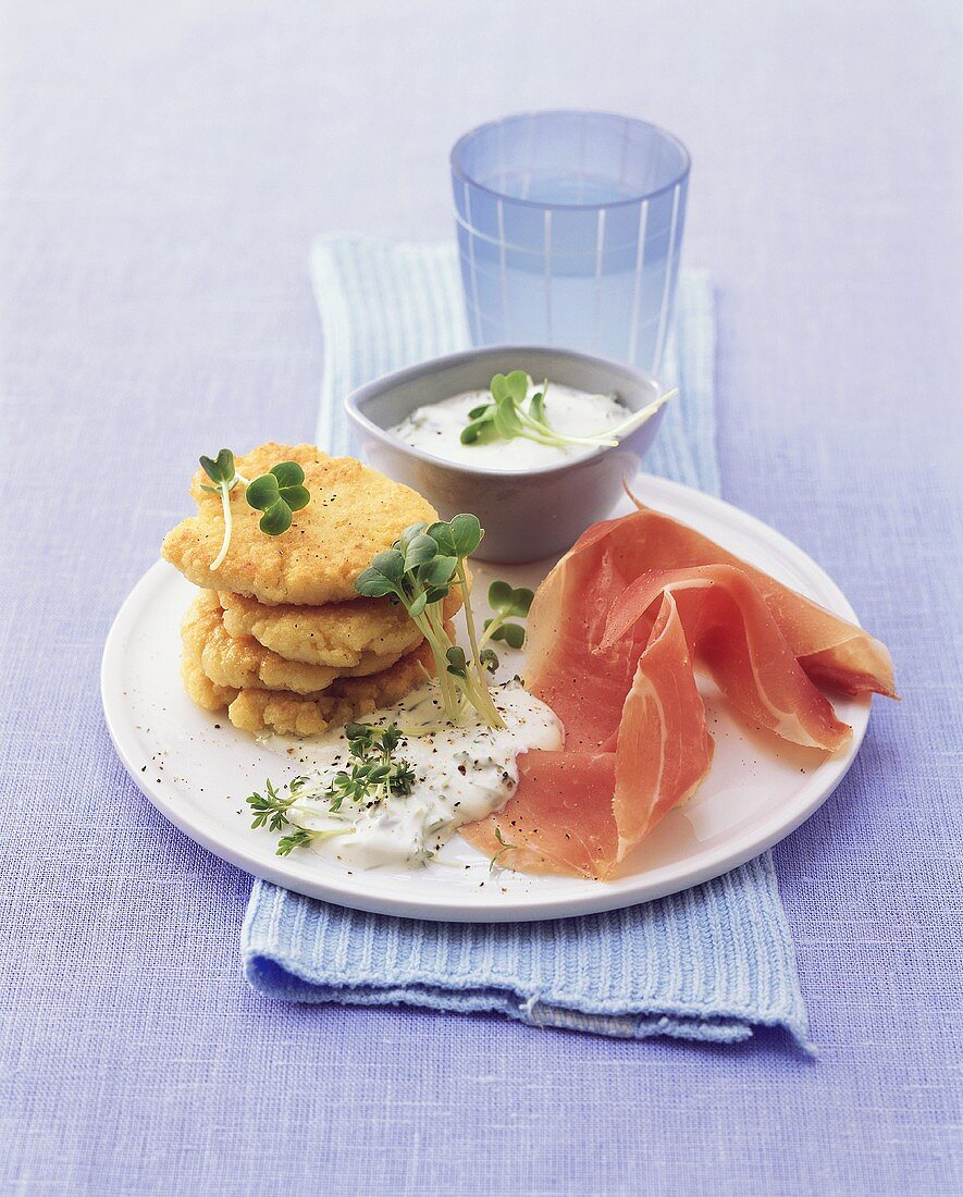 Couscous cakes with cress dip and raw ham