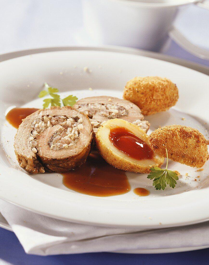 Roast pork roll with potatoes stuffed with rose hip puree