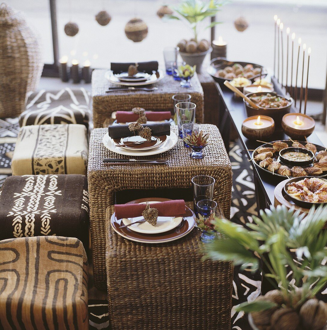 Tables laid with African theme in front of buffet