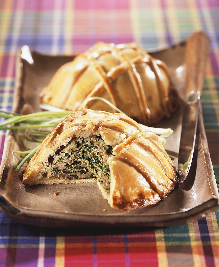 Creole fish pies with spinach