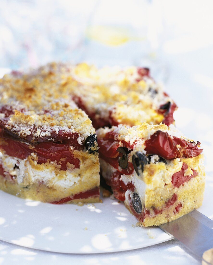 Pepper and olive cake with goat's cheese