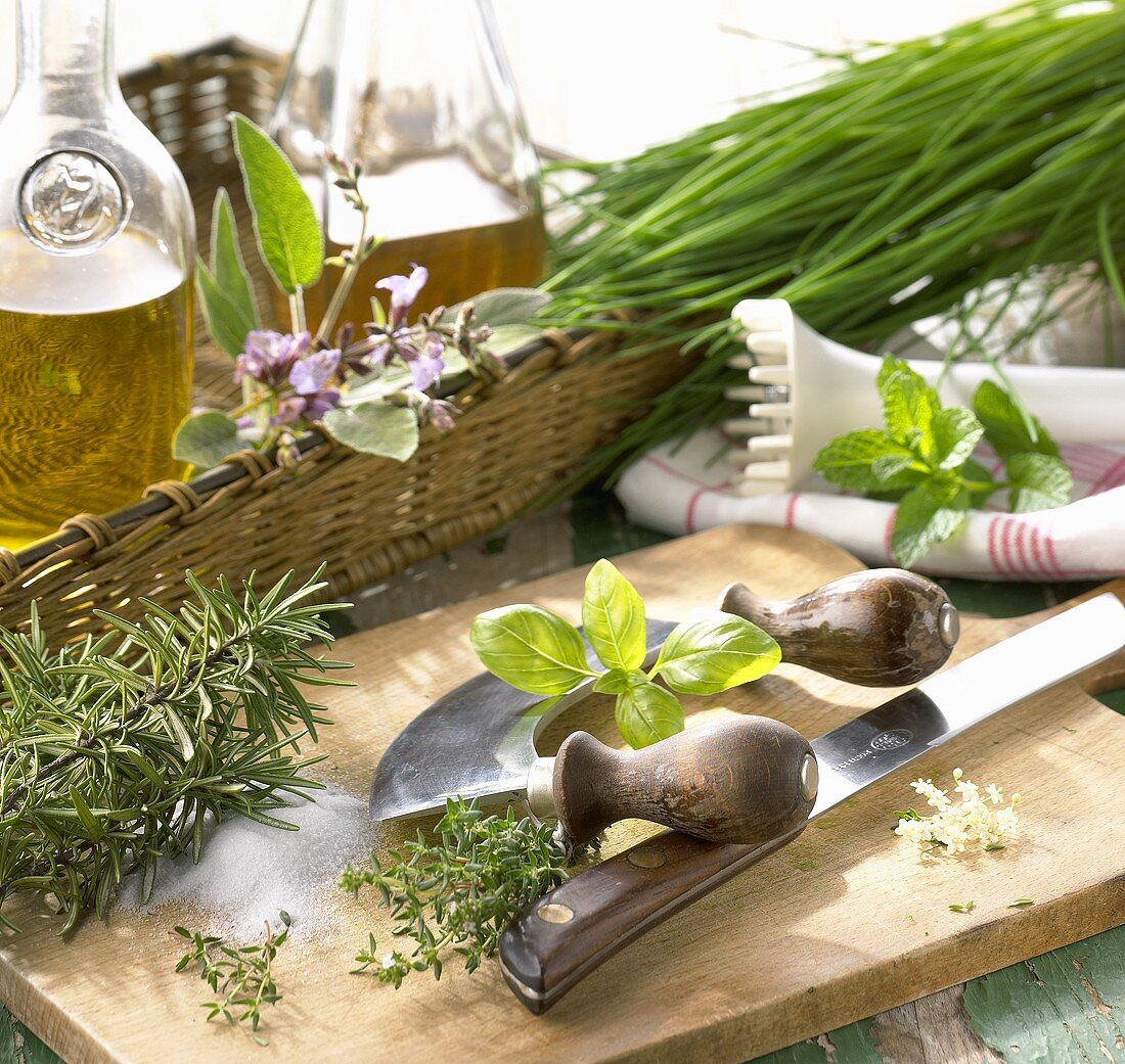 Still life with a selection of herbs, knife & hand blender