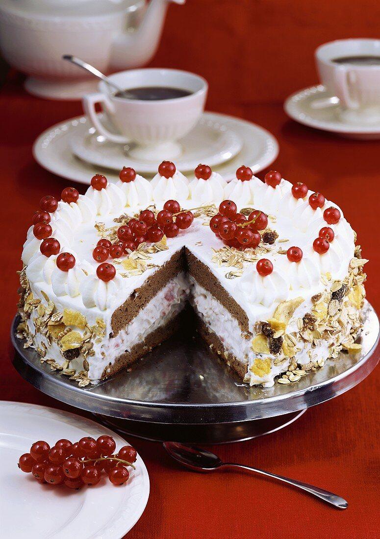 Yoghurt cake with fruit muesli and redcurrants