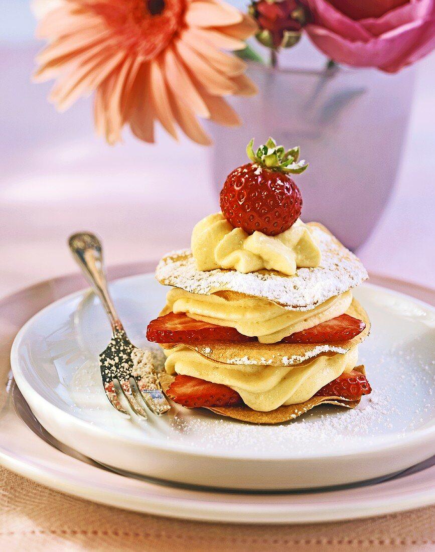 Layered strudel with vanilla cream and strawberries
