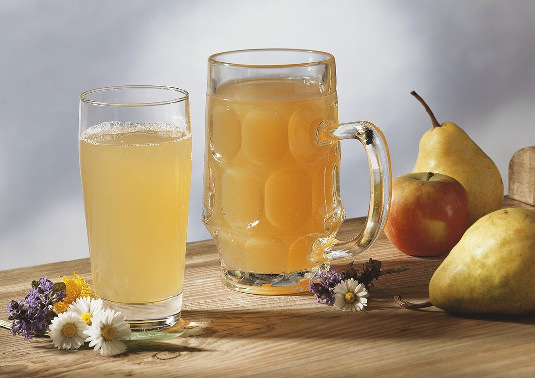 Apple and pear must in jug and glass (diluted)