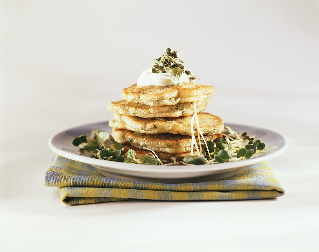 Pancakes with watercress and sour cream
