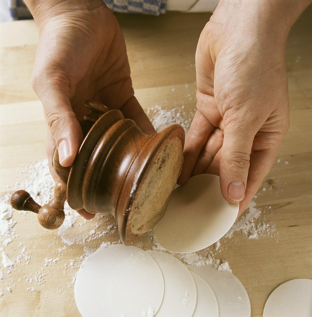 Making coconut macaroons (putting coconut mixture on wafers)
