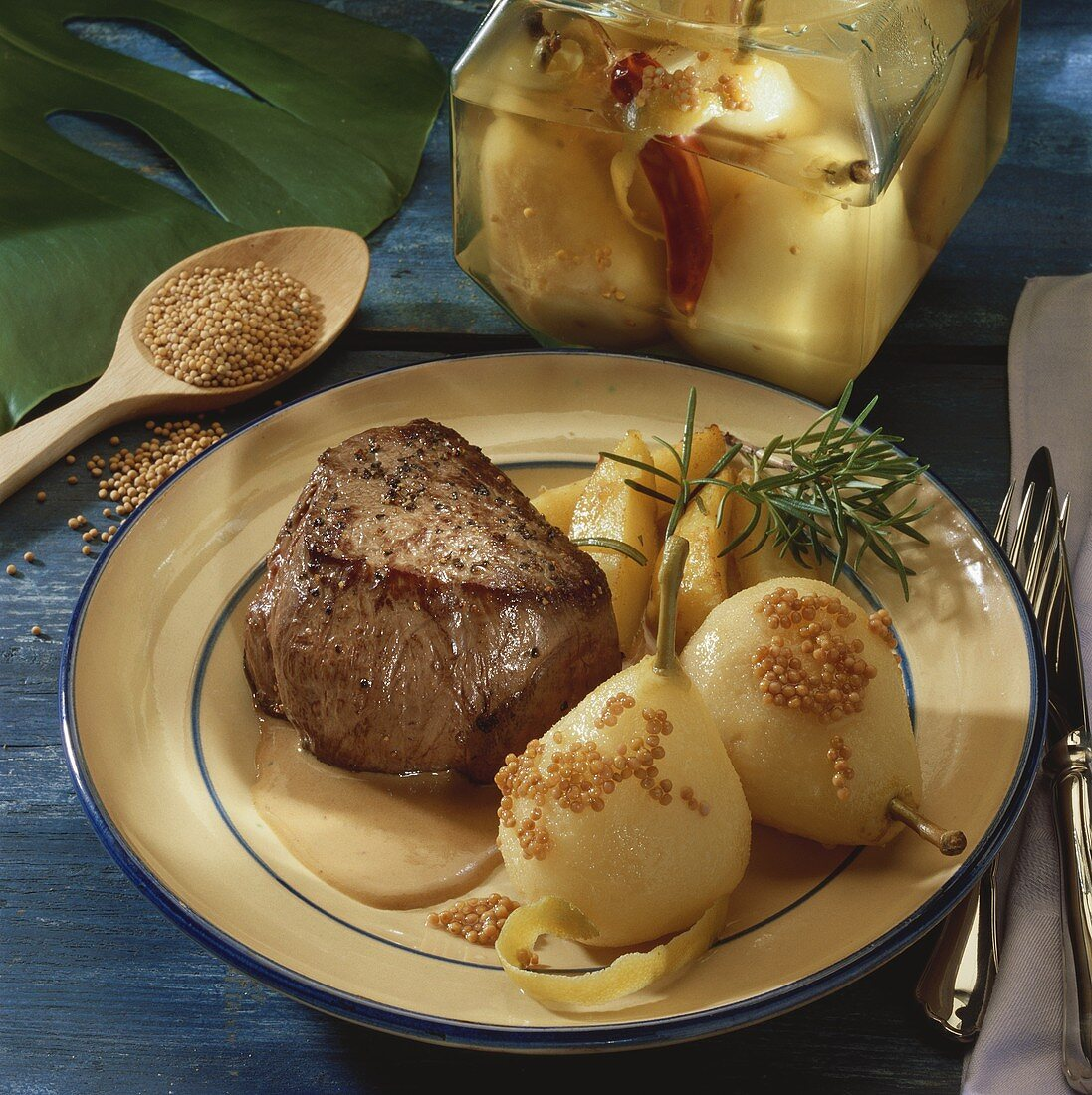 Ox fillet with pepper sauce, mustard pears & roast potatoes