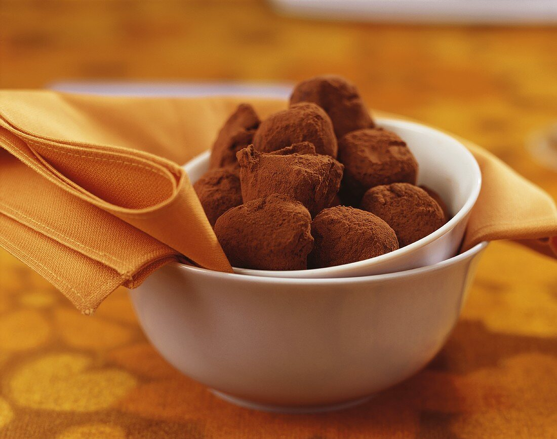 Orange sweets coated in cocoa powder