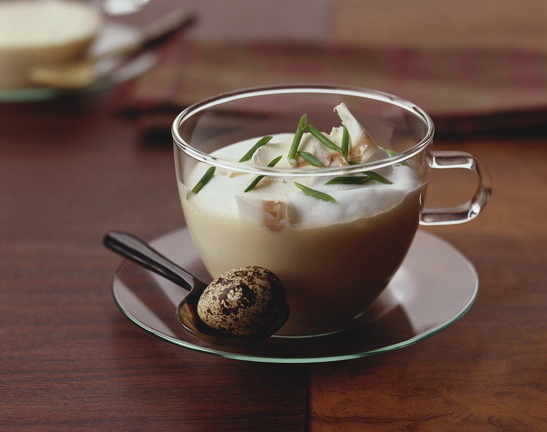 Creamed mushroom soup with quail's egg in glass cup