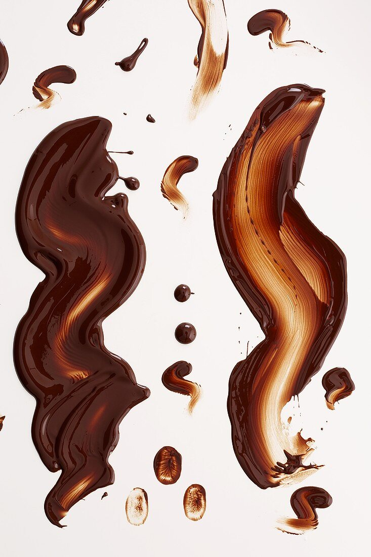 Chocolate sauce smeared on white background