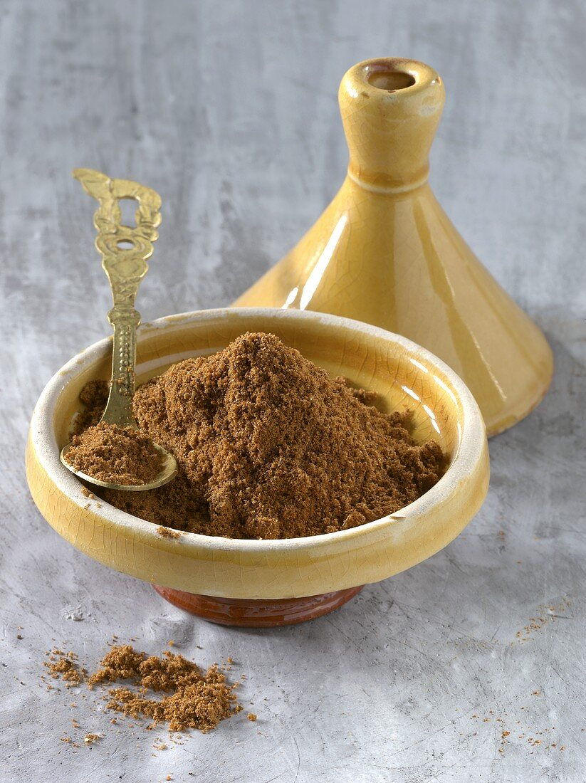 Baharat spice in yellow bowl and on spoon