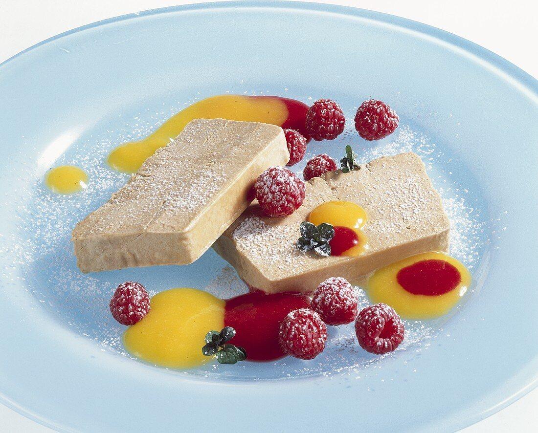 Tea parfait with fruit sauces and raspberries