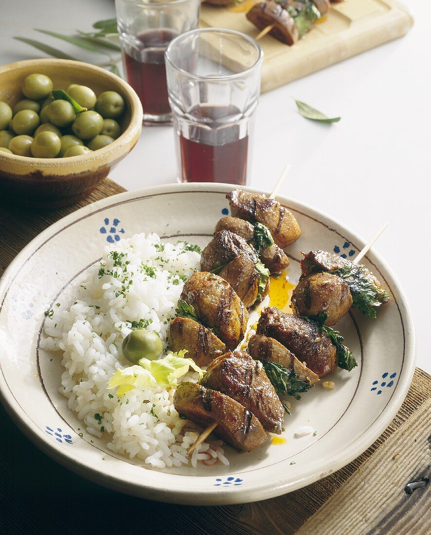 Pinchitos: kebabs with olives, rice and red wine (Spain)
