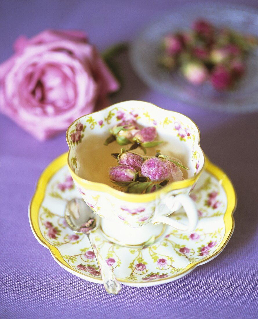 Tea with rosebuds in romantic cup