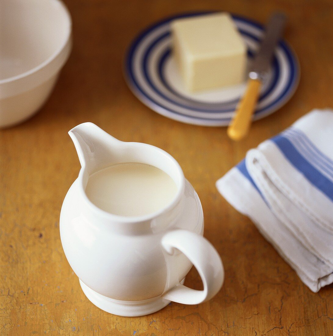 Jug of cream and block of butter