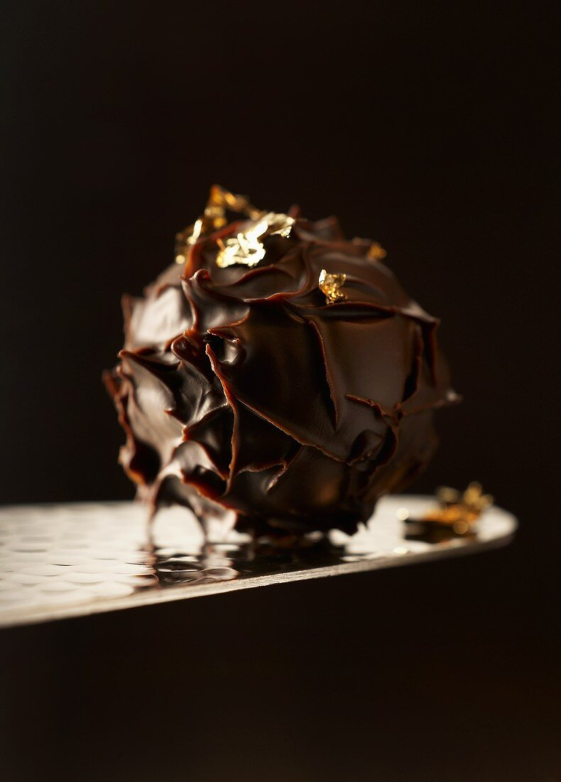 Chocolate truffle with gold leaf