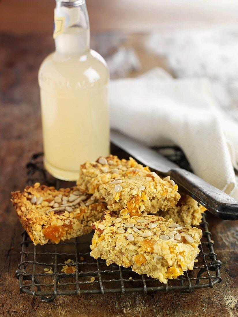 Flapjacks (rolled oat tray bake) on cake rack