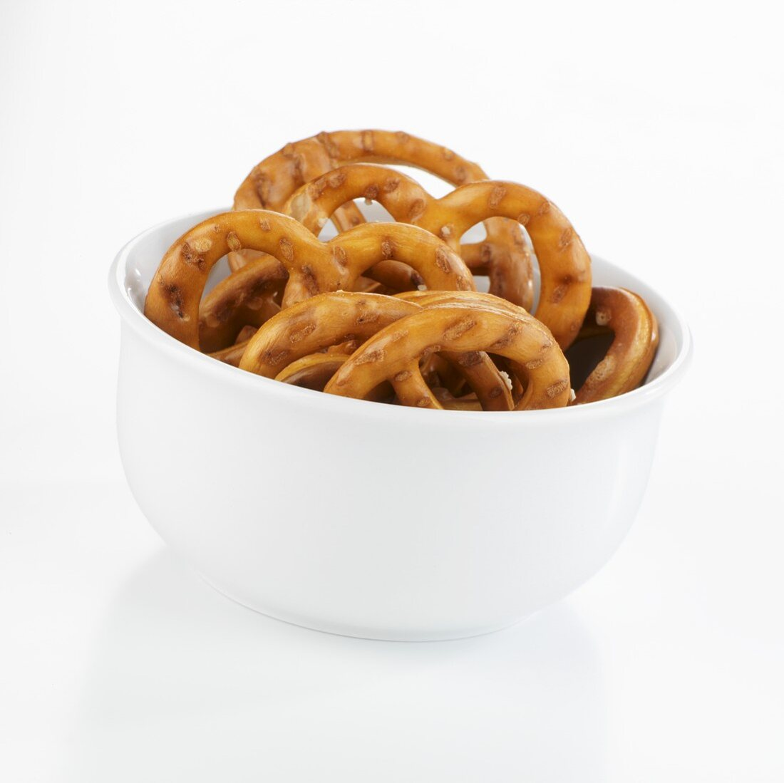 Salted pretzels in a small white bowl