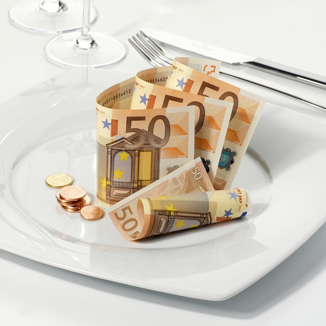 Euro notes and coins on plate