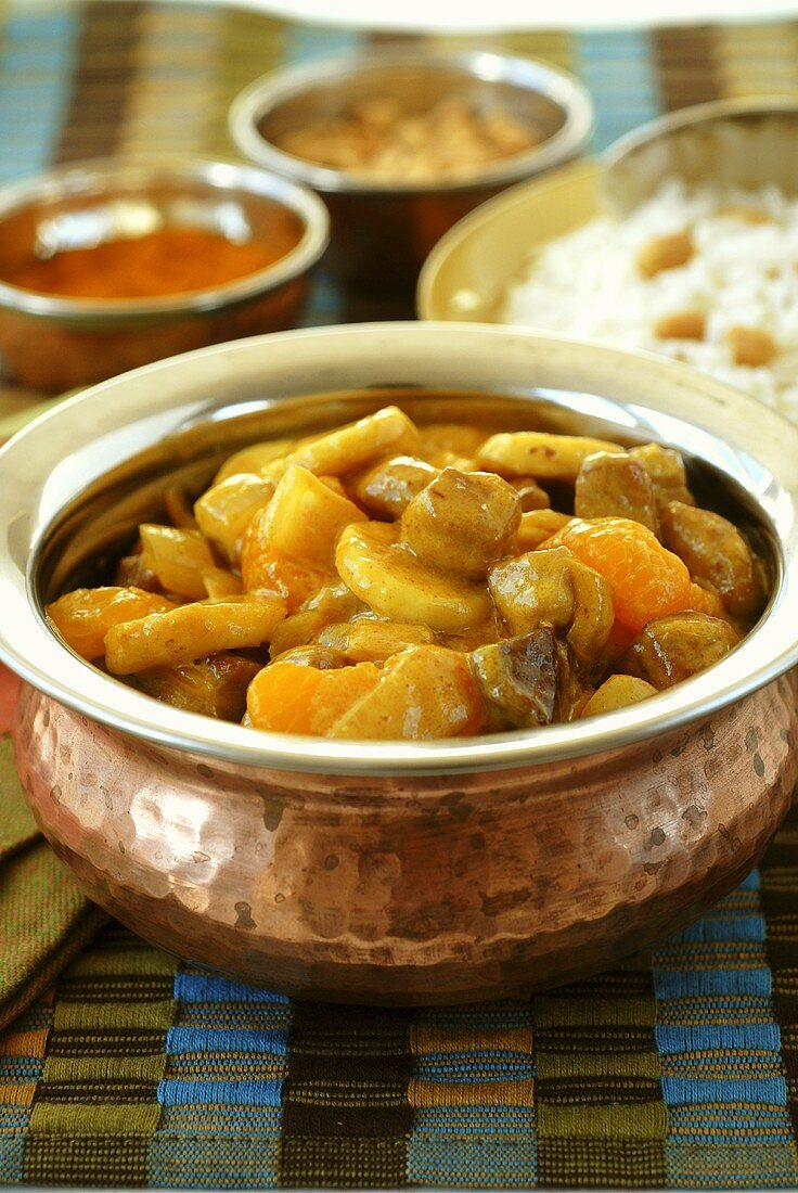 Banana curry in copper pot