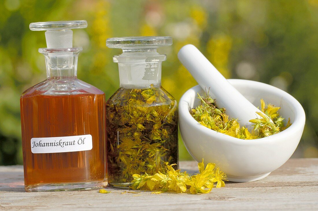 St. John's wort oil with ingredients and mortar & pestle