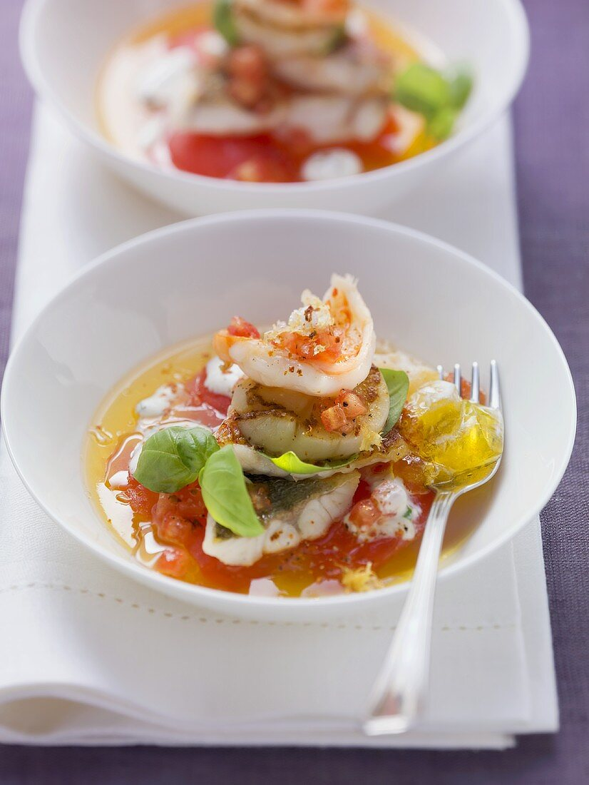 Fried seafood on tomato jelly with basil cream