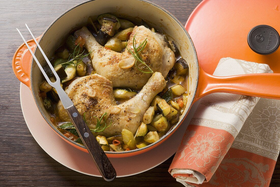 Chicken legs and vegetables