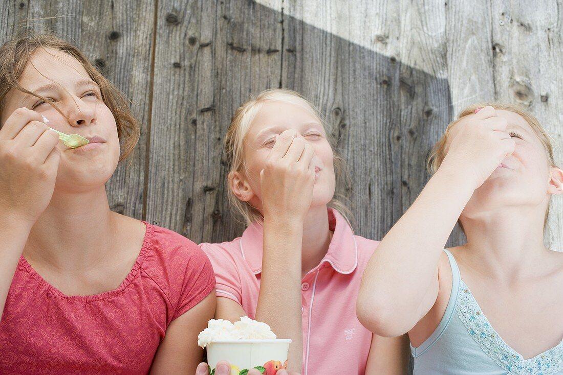 Three girls eating ice cream