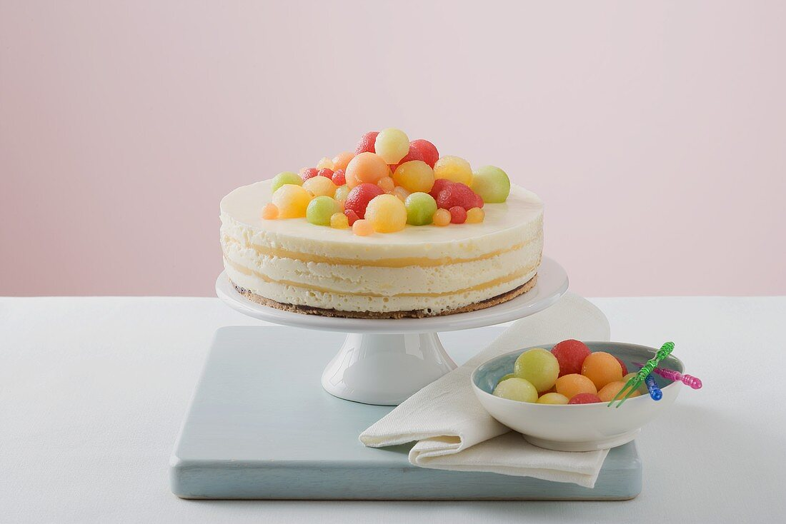 Yoghurt cheesecake with different coloured melon balls