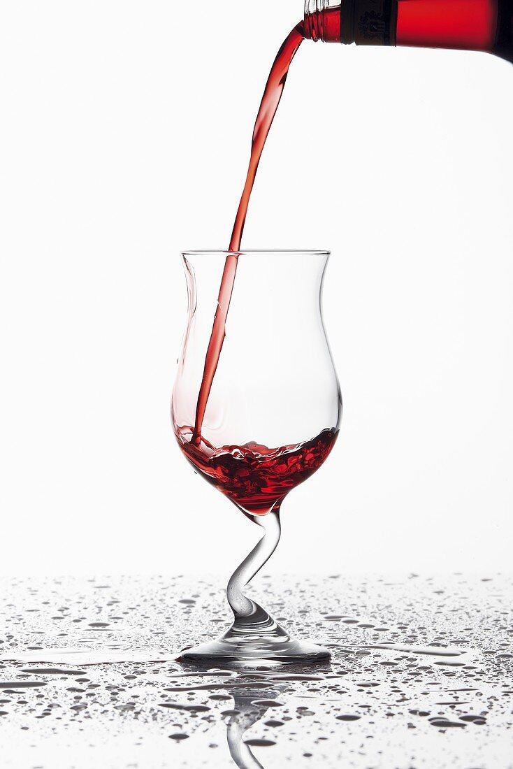 Pouring Campari into a glass