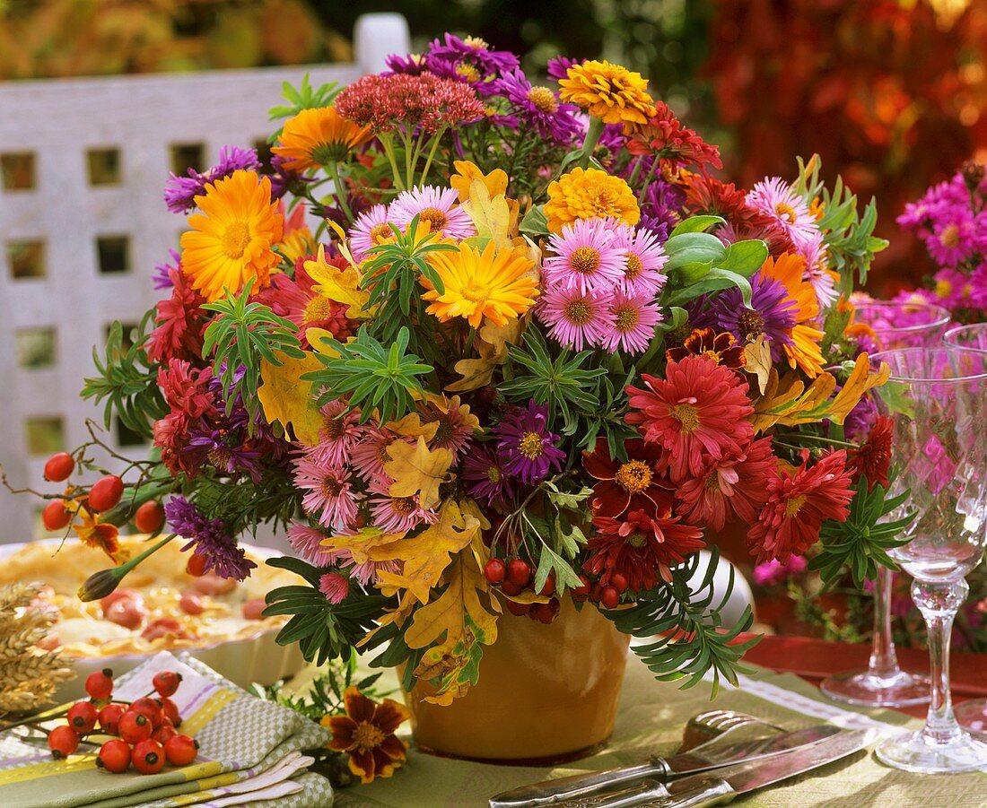 Autumn arrangement of marigolds, asters, zinnias