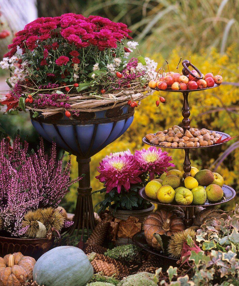 Autumn decoration: flowers, pumpkins, apples & hazelnuts