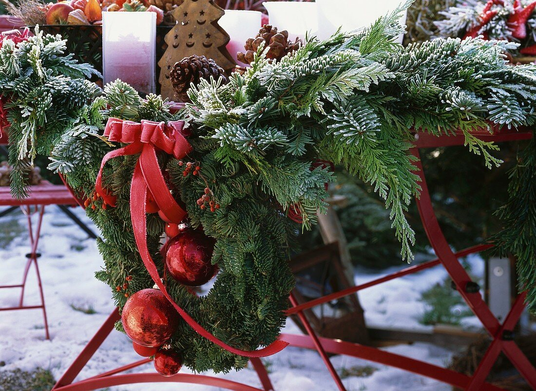 Garland of conifer greenery and door wreath