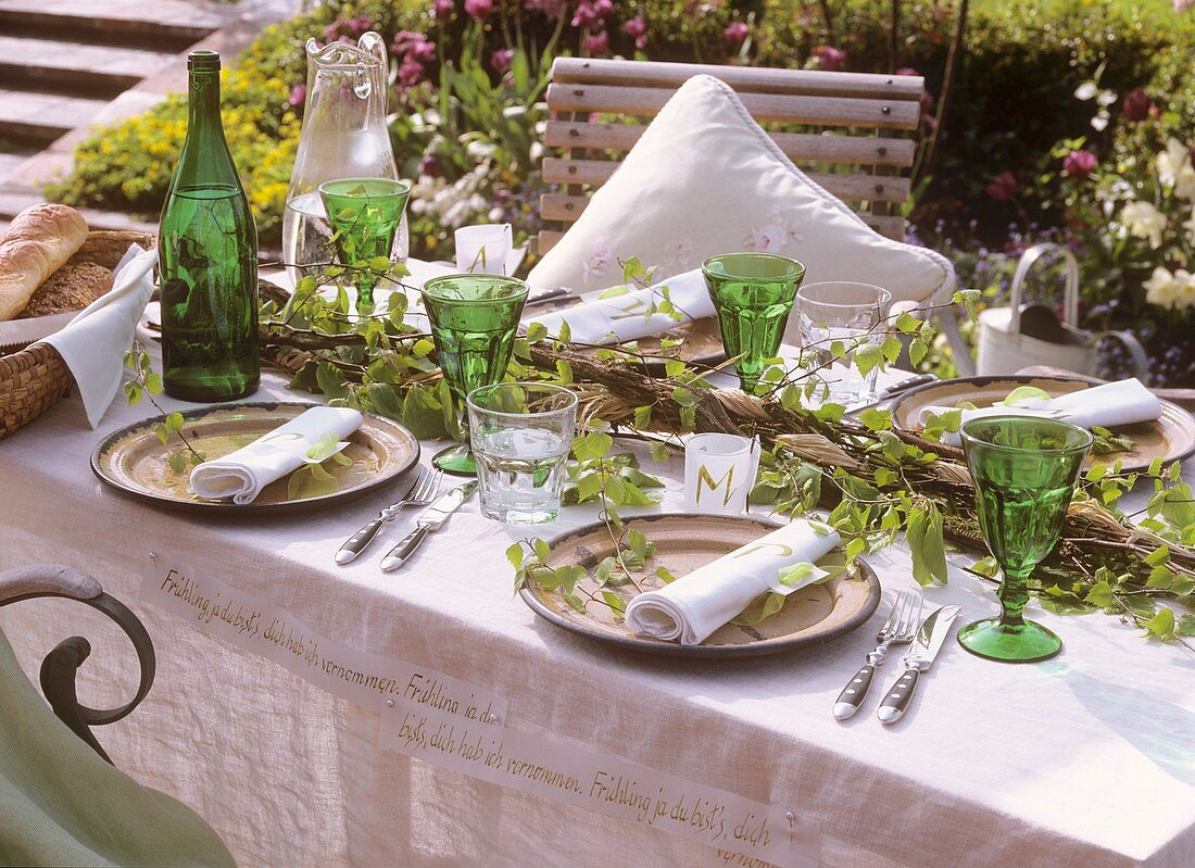 Laid table decorated with birch twigs