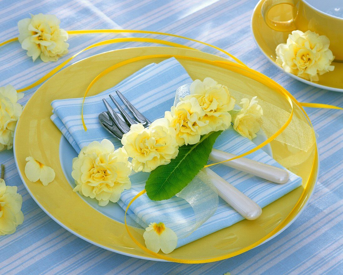 Place-setting decorated with primulas