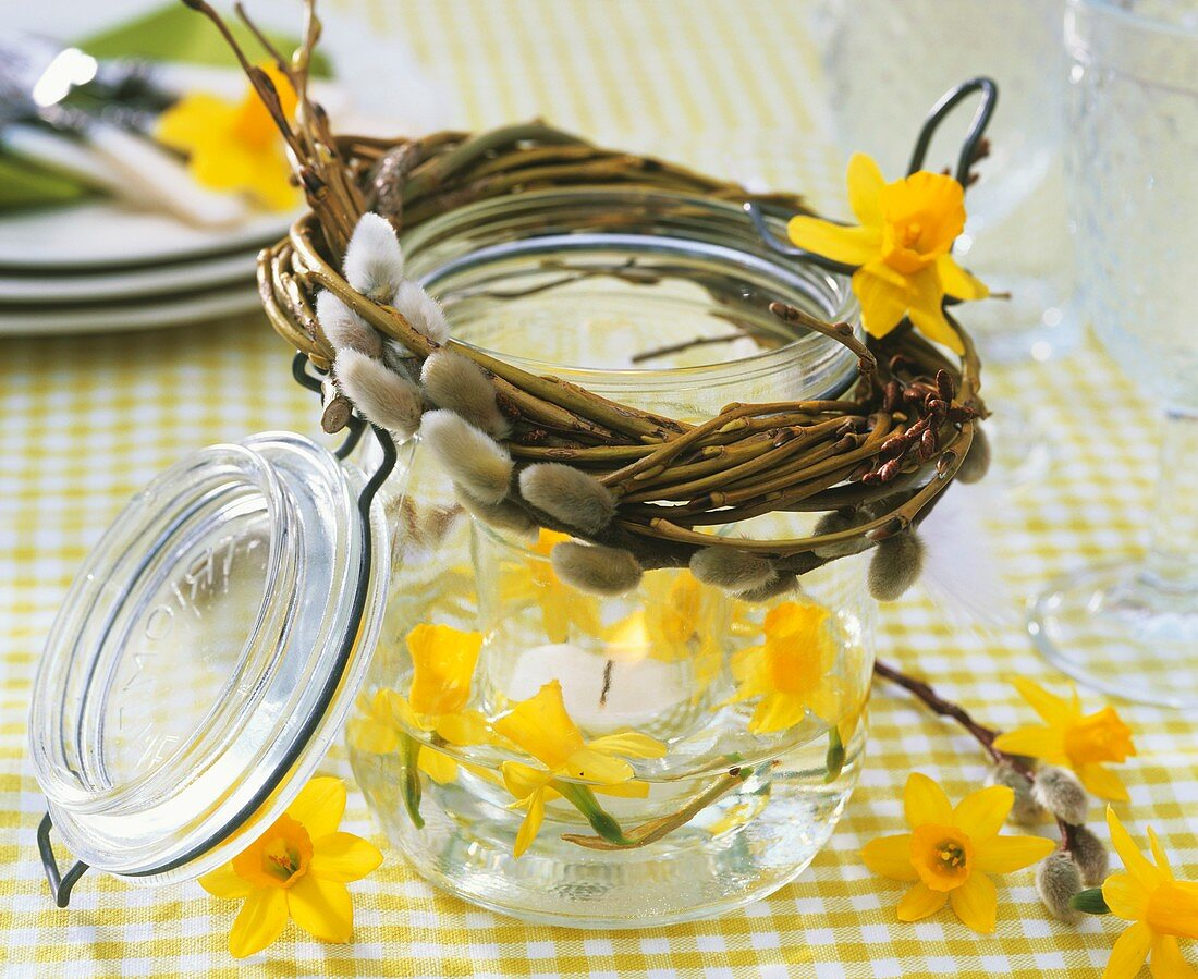 Preserving jar used as windlight with Narcissi & pussy willow
