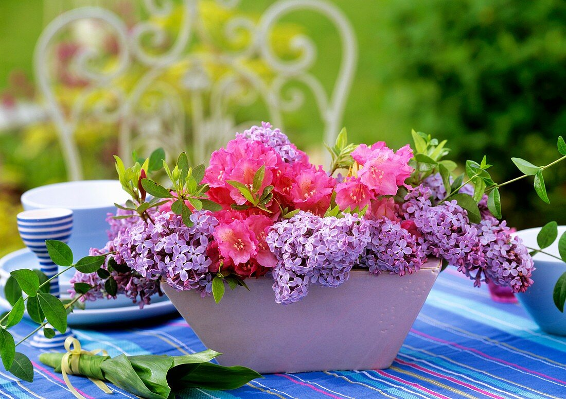 Bowl of lilac, rhododrendron and periwinkle foliage