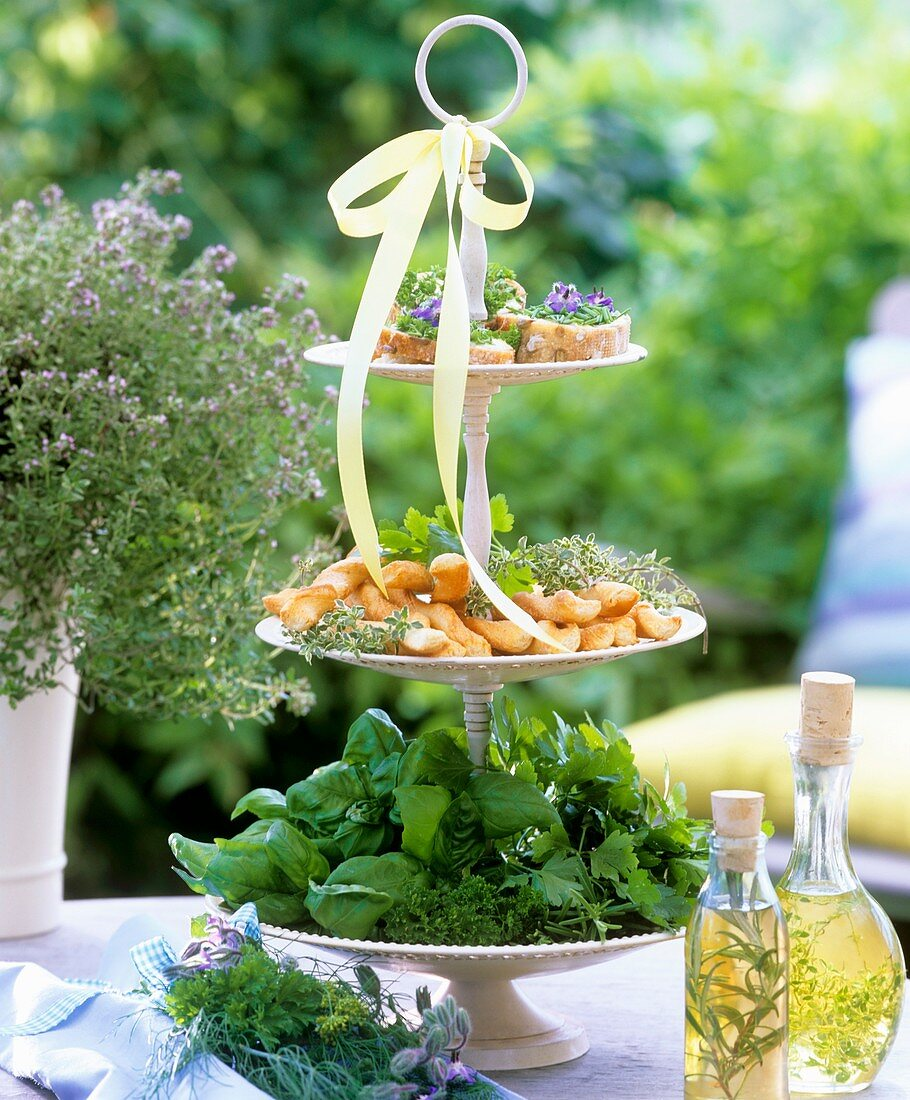 Herbs, open sandwiches & cheese savouries on tiered stand
