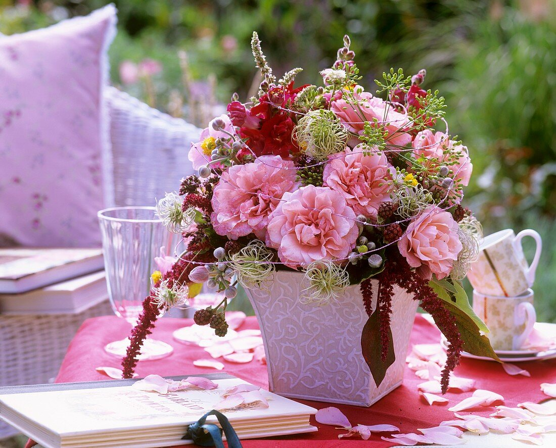 Vase of roses, snapdragons, mint and clematis
