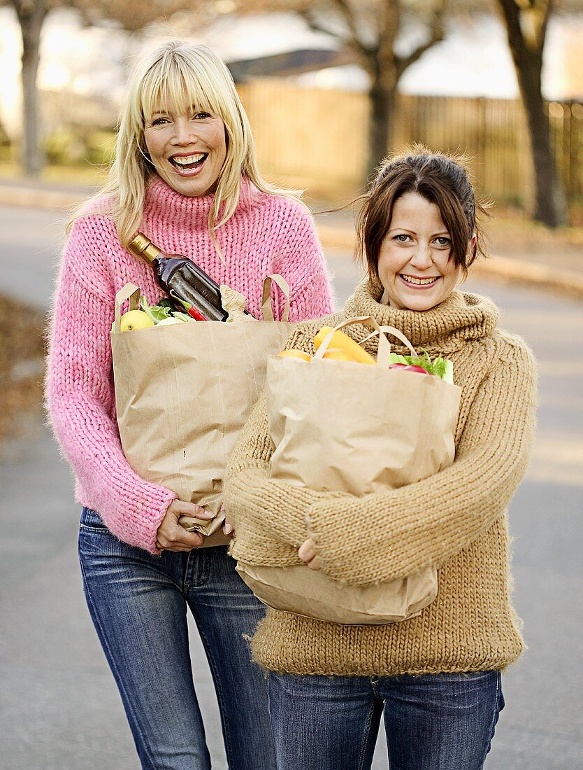 Two friends with bags of shopping