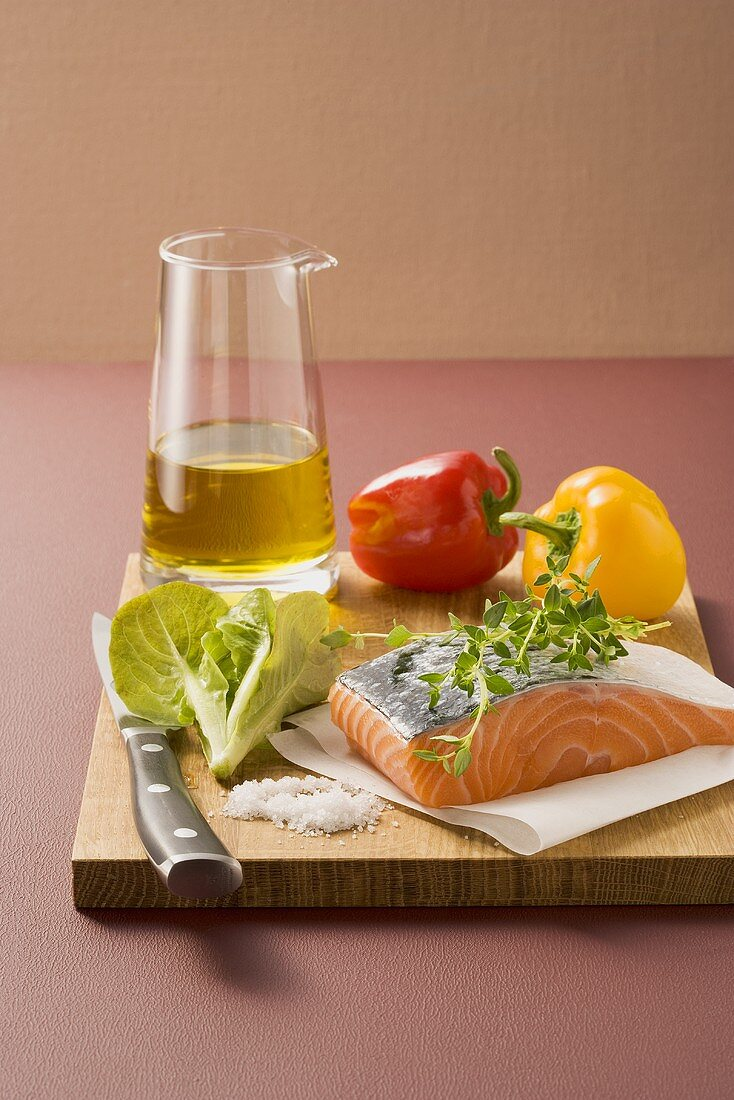 Salmon, herbs, lettuce, olive oil and peppers