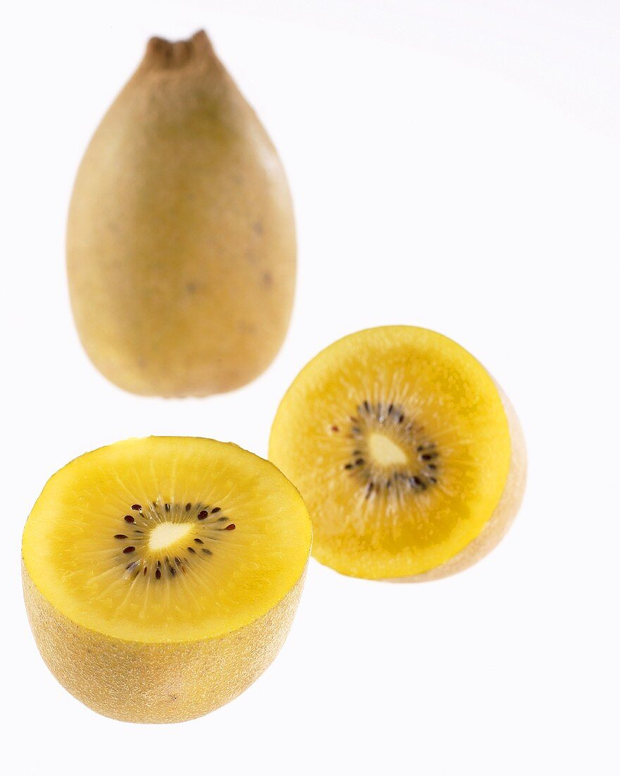 Golden kiwi fruit (Actinidia deliciosa Gold), whole and halved
