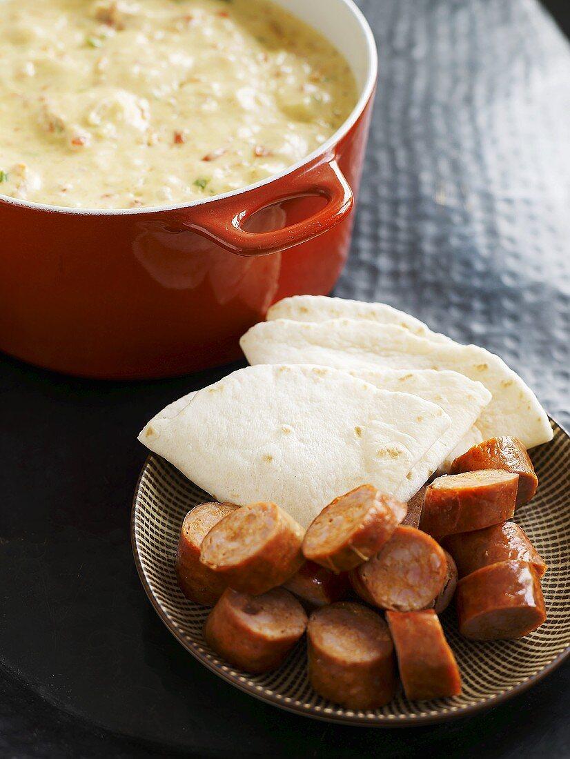 Cheese fondue with chorizo and tortilla